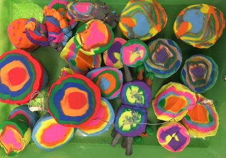aerial photo of multicoloured arts and crafts made by members of Z-artists