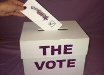 Ballot box with someone inserting a vote