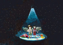 Promotional image for 'Muckers'. Cartoon image of two girls. The background is a black night's sky filled with stars and they are standing under a blue spotlight. They are both wearing mismatched clothing and there are piles of clothes to either side of them.