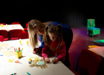 Photo of a woman and child doing arts activities