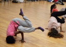Photo of two teenage girls break dancing in a dance studio