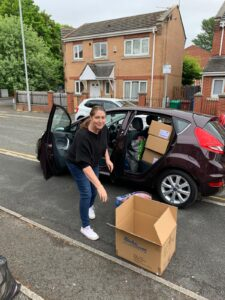 Woman getting boxes out of car