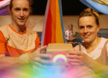 Man and woman holding rainbow box