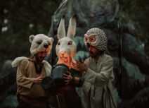 People dressed as owl, hare and bear