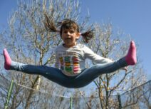 Child doing splits in the air
